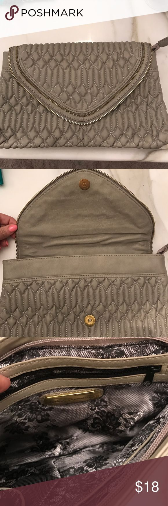 Grey clutch bag In excellent condition. No signs of wear. Used once. Matches any outfit. Gold zipper. Bags Clutches & Wristlets