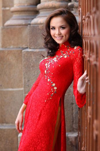 Sheer and lace red ao dai with flowers. White or gold pants, perhaps