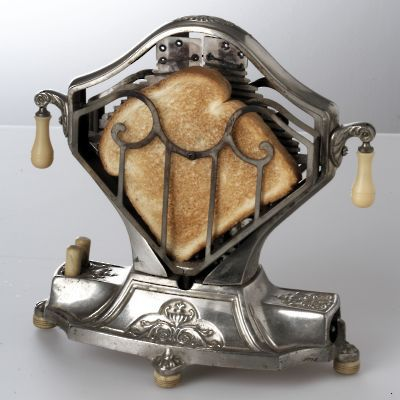 Toaster-of-the-1920s ~ the Sweetheart ~ I don't know that I would want to use it but I sure want one on display in my kitchen!!!