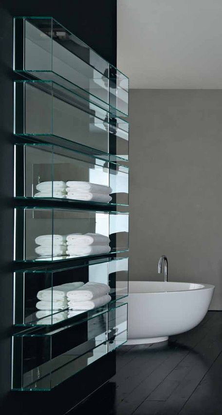 Glass shelving in the bathroom...with mirrors behind.  WOW