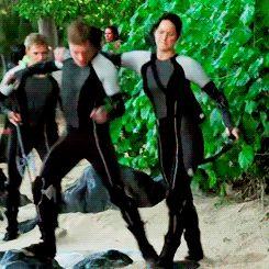 Jen trying to get Josh in a headlock. << Haha Peeta's not going down that easily