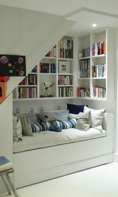 Home Organizing Ideas -- Under-Stair Bookshelves and Seating Area - looks like…