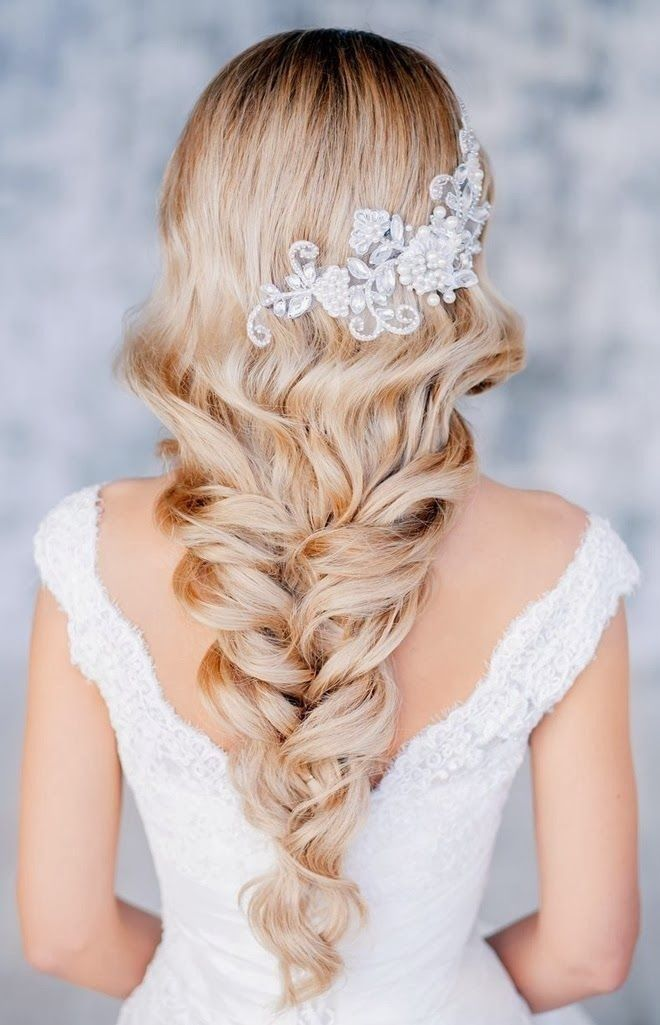 I don't know how it's kept in place, but this hairstyle is lovely. It's like a braid and curls at the same time.