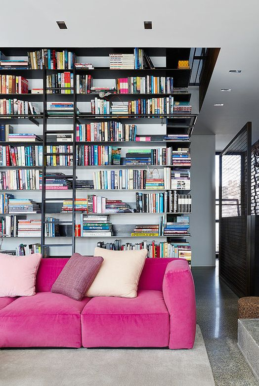 Giant wall of books steals the show in this exquisite Melbourne living room…