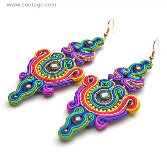 Purple Raksha earrings are the breath of ancient India. There are the colors of temples and floral wreaths. Using materials: hematite stones, glass beads, soutache Length of earring: 9 cm Width of earring: 4 cm Handmade by soutache technique. Its possible to order in different color
