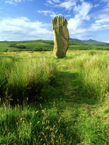 Standing Stone, Arran, Scotland-It just blows my mind when I see these,  how did they get them there. They weigh TONS and then there aren't even any other rocks around.