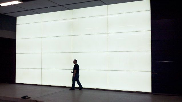 Backlit recycled glass panel feature walls at sustainable for Glass panel walls