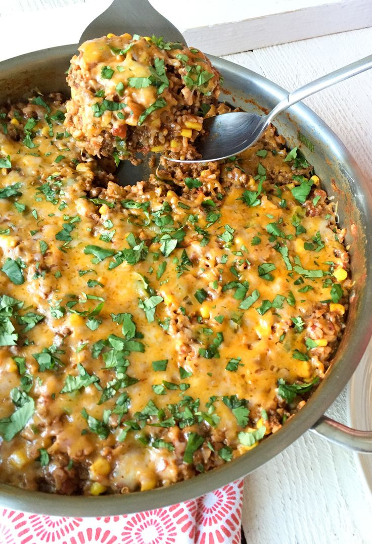 My One-Pan Cheesy Mexican Rice with Ground Beef is the ultimate one-dish meal! It's easy enough for weeknight dinners, and it's kid and family friendly, as well as low fodmap and gluten free. Click to get the recipe and a bonus sneak peek at the Calm Belly Kitchen Cookbook: Crave-Worthy Low FODMAP Recipes for Everyday!