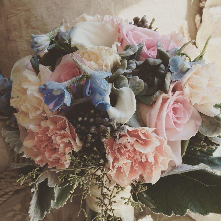 Peach carnations, white mini calla, brunia berry, light blue delphinium by In Full Bloom Flowers LLC