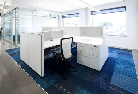 White Artopex task seating and office furniture with flashes of the corporate blue create a bright and inspiring environment for all employees.