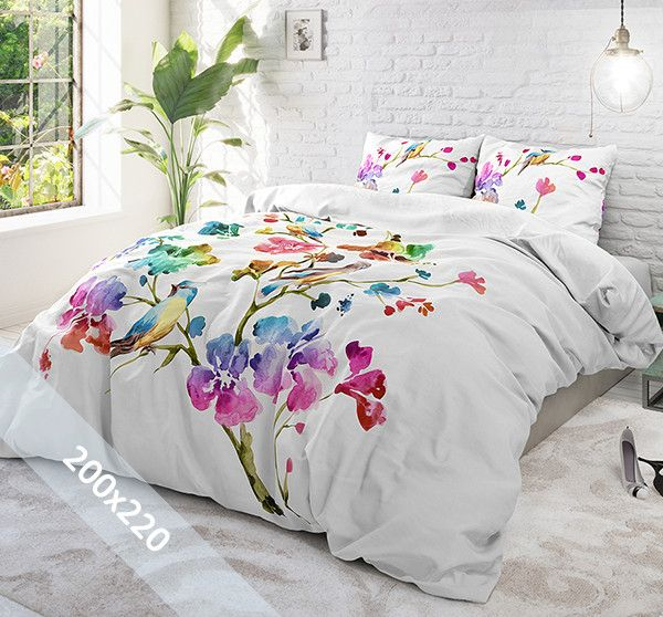 Sleeptime Pure Cotton dekbedovertrek 'Valeria'. Een tweepersoons (200x220 cm) dekbedovertrek van 100% katoen met als basis een witte achtergrond. Daarop zijn verschillende grote bloemen gedrukt in alle prachtige kleuren van de regenboog.