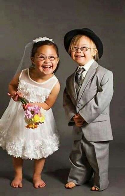 Cute kids as flower girl and ring bearer;   Down Syndrome