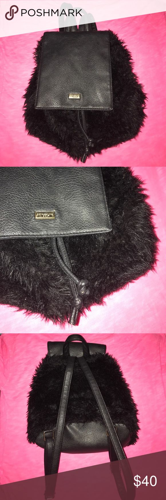 Fluffy Clueless style backpack by NYC Expressions Faux fur black mini backpack, adjustable straps, zipped pocket inside and two pockets on inside. By NYC Expressions. Has a slight flaw on fur as shown on photo. Super cute style. Similar to Chanel, NastyGal & Dollskill style Nasty Gal Bags Backpacks
