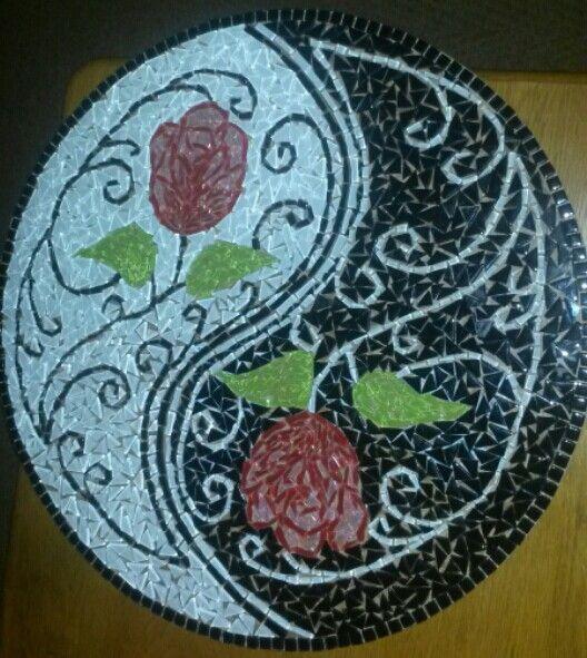 Yin and yang roses done in mosaics.