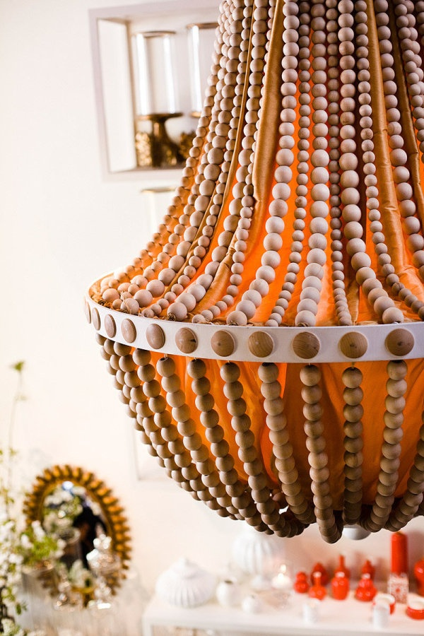 all eyes are on this orange chandelier   Photography by kuperberg.com