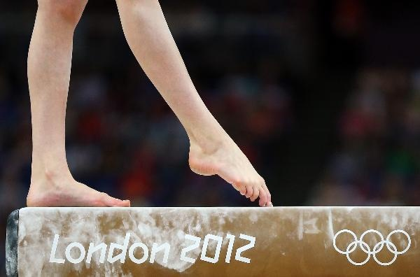 Rebecca Tunney of Great Britain performs on the beam in the Artistic Gymnastics Women's Team qualification on Day 2 of the London 2012 Olympic Games at North Greenwich Arena on July 29, 2012 in London, England.