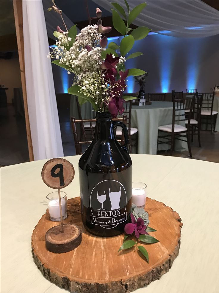 Growlers used for a table centerpiece . Brewery wedding, rustic, outdoor theme in Fenton Michigan. #michiganweddings #weddingvenue