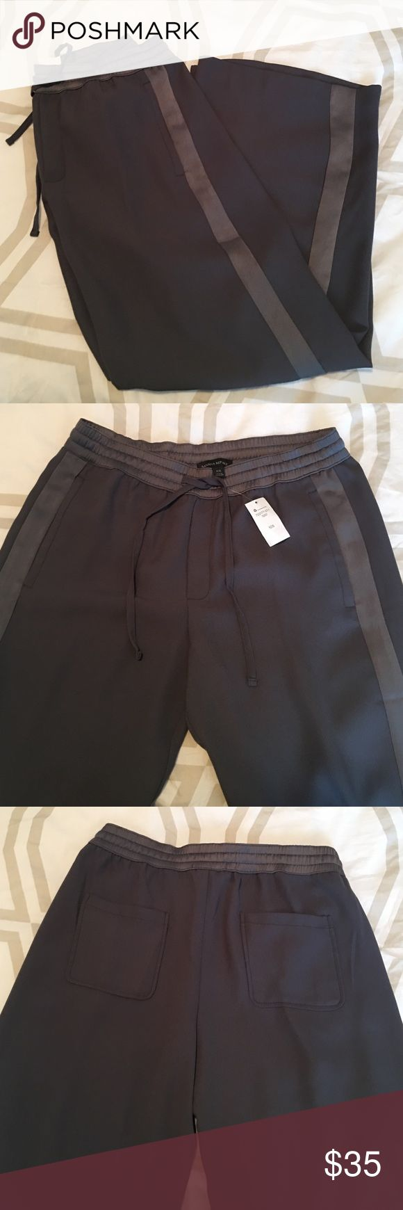 """NWT Banana republic grey pants. NWT banana republic wide leg grey """"tuxedo"""" stripe pants. 100 % polyester. Size 10 short. ( I never buy short but I wanted to wear them with sandals) super light weight and silky perfect to dress up or down! Banana Republic Pants Wide Leg"""