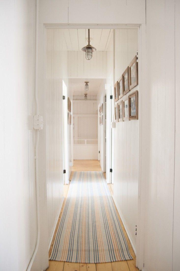 Hallway of seaside cottage, Benjamin Moore White Dove | Remodelista