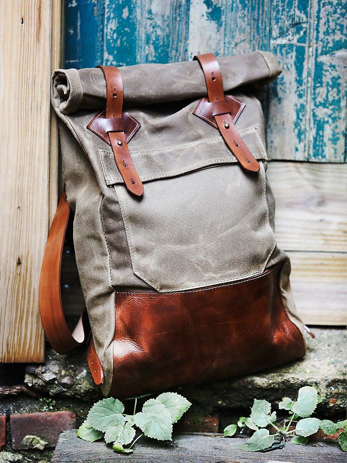 Wolf Hill Adventure Backpack | Handmade in Colorado, this ultra-rugged backpack features a waxed canvas body and English bridle leather straps. Featuring a roll-top closure and adjustable/removable straps for an easy, convertible wear. Brass hardware and reinforced leather bottom lend way to a lived-in aesthetic.