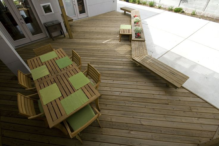 Pressure treated pine deck with benches and planter boxes.
