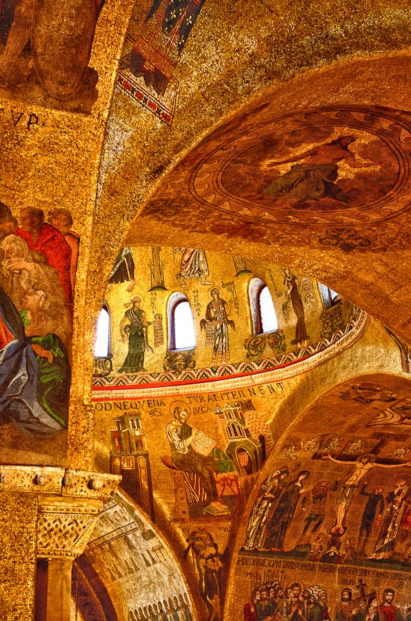 GOLDEN MOSAICS OF SAN MARCO, VENICE The light reflects on the mosaic walls, arches, and ceilings made of hundreds of thousands of tiny golden tesserae or tiles in the Cathedral San Marco in Venice. It looks like golden fire ablaze in the afternoon sun.