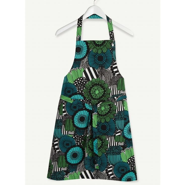 New to Marimekko textiles is this gorgeous pieni siirtolapuutarha flower apron. Part of the 'In Good Company' range from Marimekko, which combines the styles of Rasymatto and Siirtolapuutarha and was created by designer Maija Louekari. A contemporary illustration in black, white, green and turqouise, modern blossoming flowers, foliage, fruit and veg design, perfect fresh and bright apron to wear, practical with its  neckband with 3 snap settings, large front pocket and generous waist straps…