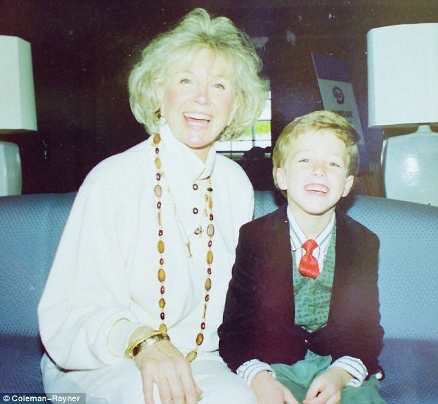 Doting: Doris Day in an unseen picture with her grandson Ryan Melcher, the son of her only child Terry and his wife Terese. Ryan is now a realtor in Carmel