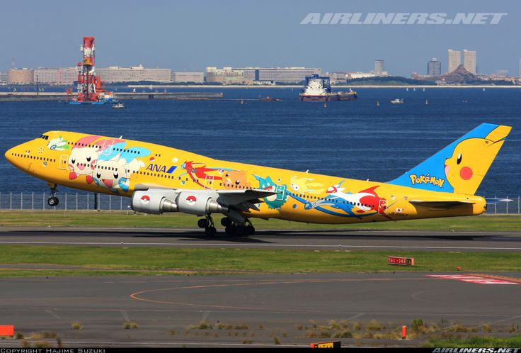 ANA Airways (All Nipon Airways) (JP) Historic fleet Boeing 747-481(D) JA8957 aircraft, painted in ''Pokemon (yellow)'' special colors May 2004, landing at Japan Tokyo Haneda International Airport. 18/09/2010. (Pokemon yellow=a 1998 role-playing video game by Game Freak published by Nitendo for the Game Boy handheld video game console).(The plane withdrawn from use 30/09/2013, stored at USA Mississippi Tupelo Regional Airport 25/10/2013 & broken up there at 2014).
