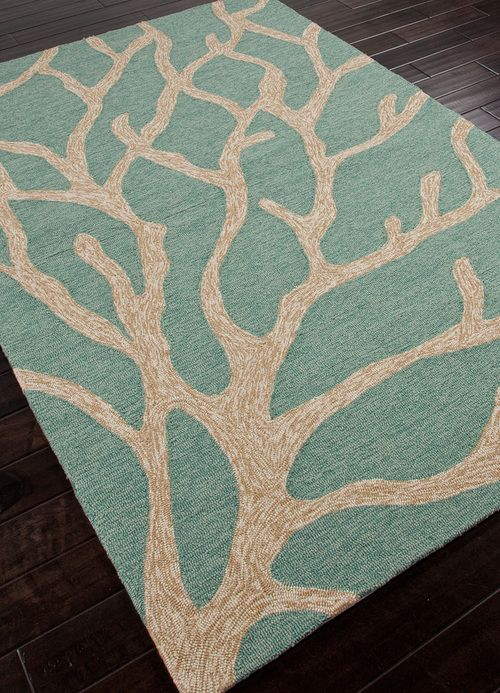 Lovely, durable indoor-outdoor teal and beige-ivory coral themed coastal area rug. Perfect to anchor any outdoor seaside living space!