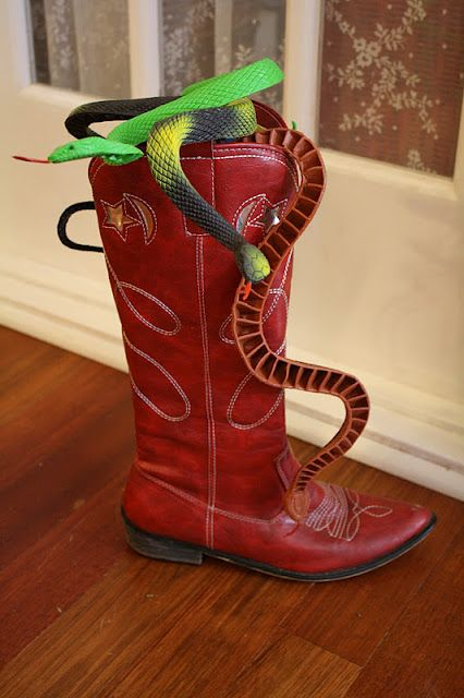 There's a Snake in my BOOT! For the table... I can use Urbans toy story light up boots for this!!!