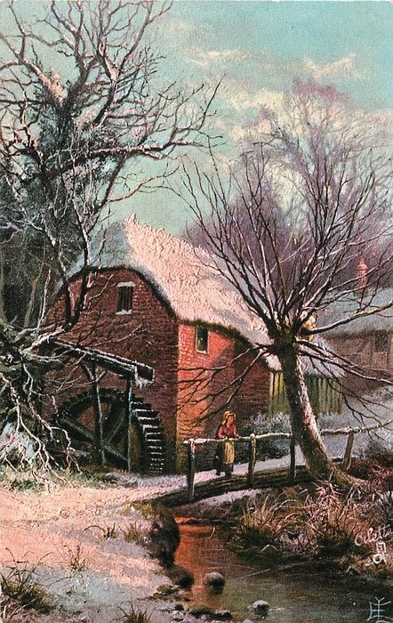 woman standing on bridge in front of mill with waterwheel