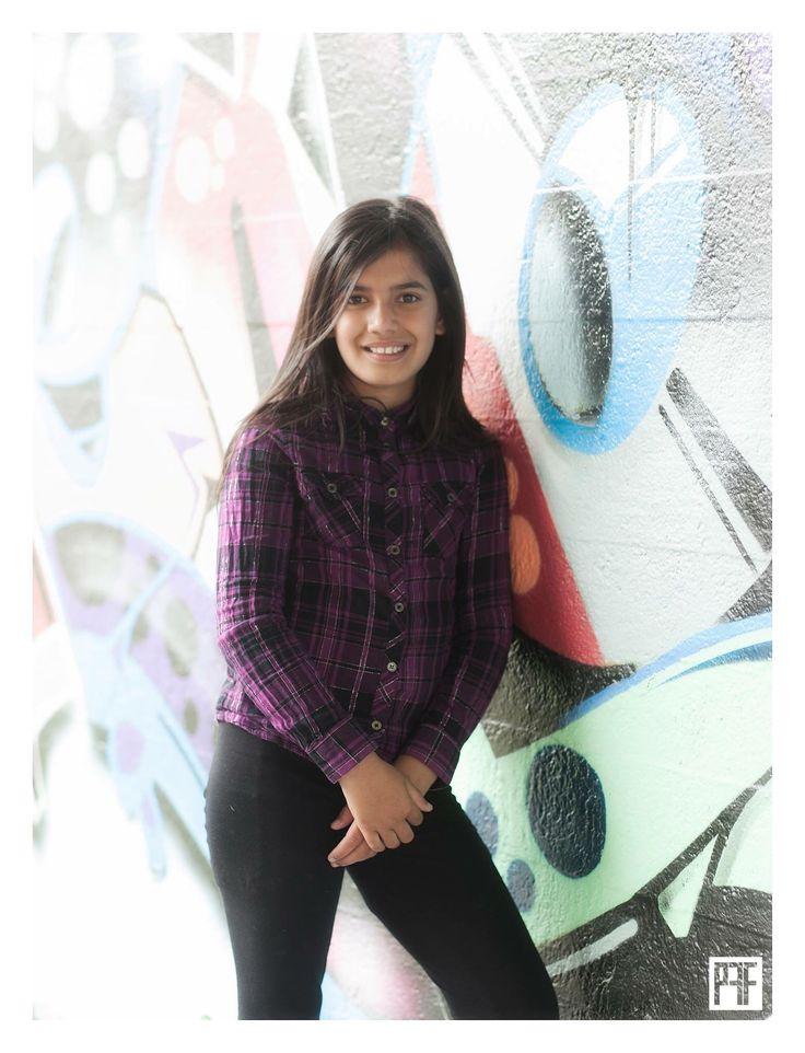 Graffiti wall posing