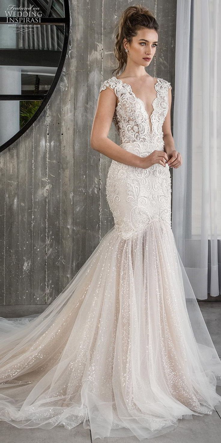 5f2a29fb Embellished lace mermaid wedding dress with tulle skirt. Sparkly deep v  plunging wedding gown. See more gorgeous bridal gowns by clicking on the  photo