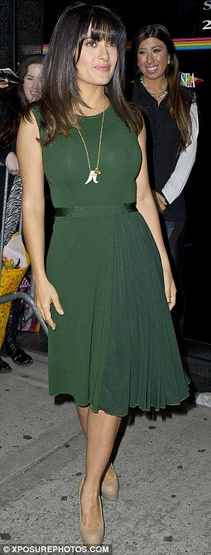 Gorgeous in green: The 46-year-old star looked stunning in the green chiffon knee-length attire, which featured small pleats in the skirt