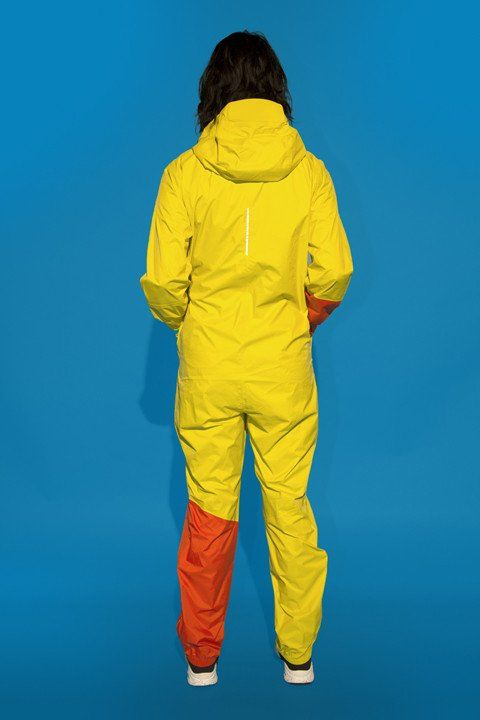 RAYNSIE DIP YELLOW RED  RAYNSIE is a weatherproof coverall, optimized for city riders. Premium performance raingear, designed to welcome any meteorological challenge with open arms. It's waterproof, windproof, breathable and packable.  www.raynsie.com