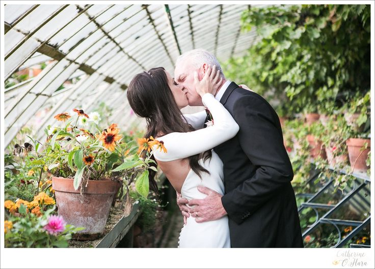 A sneaky kiss in the glasshouse after your wedding ceremony, perfectly organised by Fête in France    www.catherineohara.com    English speaking wedding, elopement, engagement and surprise proposal photographer based in Paris, France