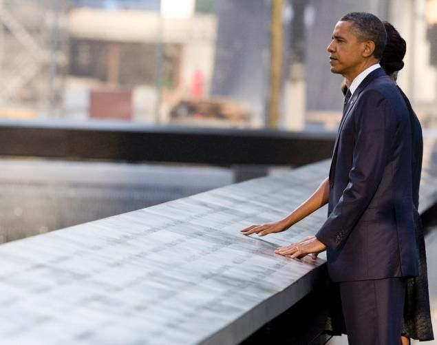 Barack Obama and his wife Michelle visit the North Pool of the 9/11 Memorial in New York City during the tenth anniversary memorial ceremony at the World Trade Center site.