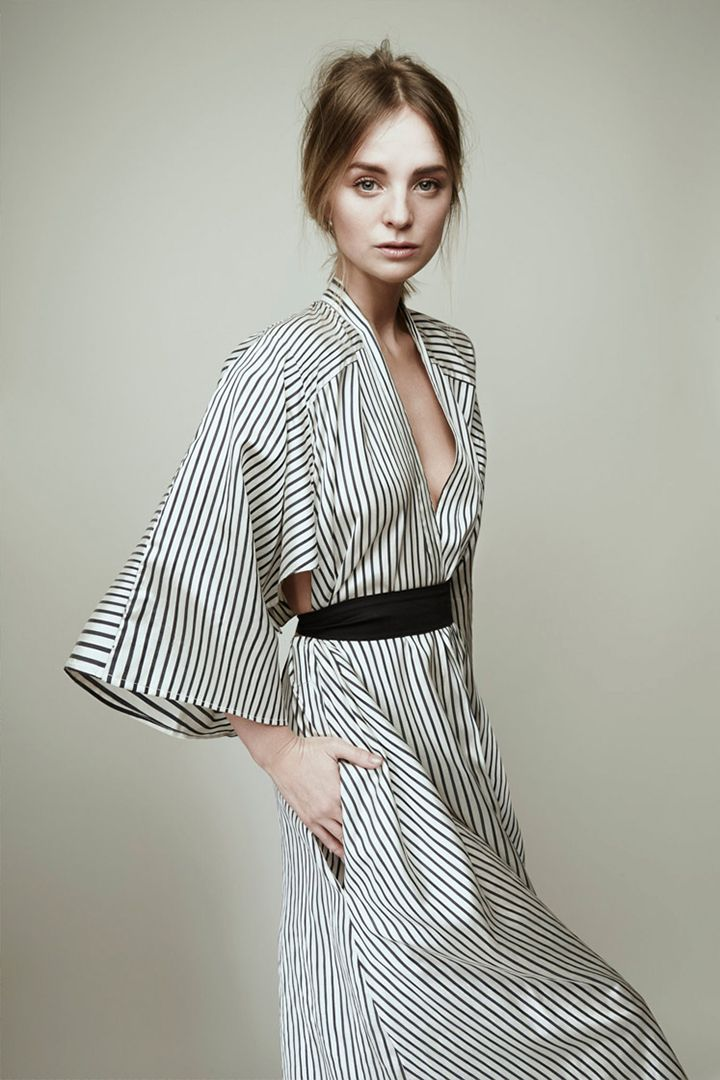 This is a great modern kimono dress. It has the loose, wide sleeves and is belted at the waist. I love stripes so of course I love this. It also has a hint of a cut out in the back which I love.