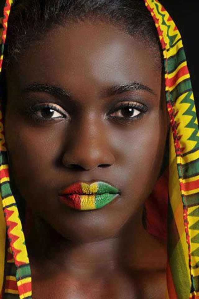 Ghana.woman with painted lips, the color of the Ghana flag.