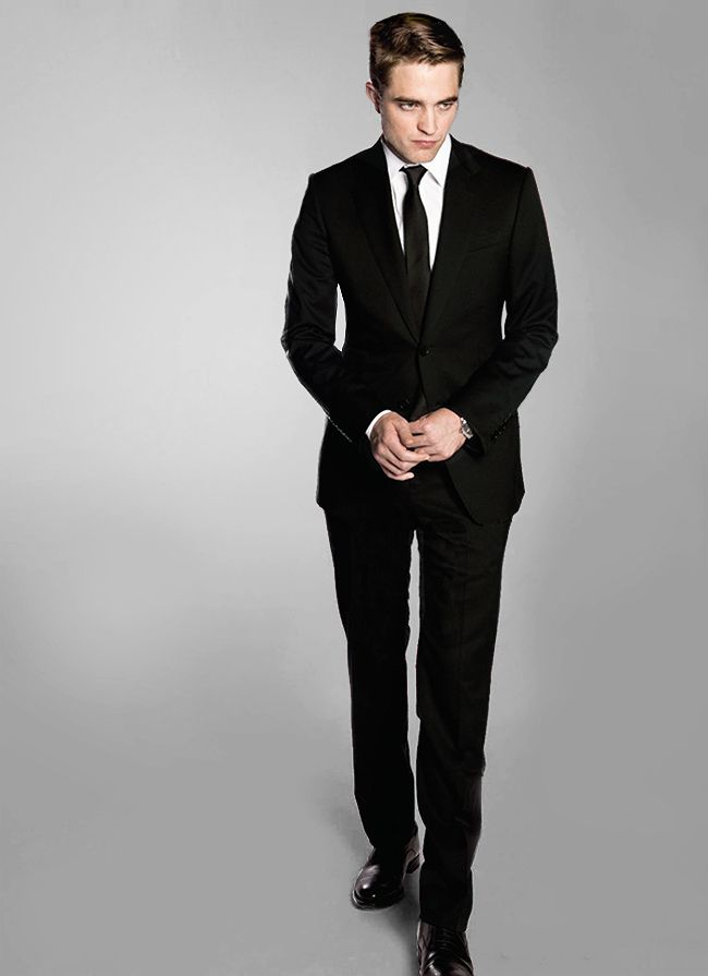 The suit Eric wears in the film is by Gucci: the Signoria, two-button notch lapel, in black. It is definitely available to mere civilians.