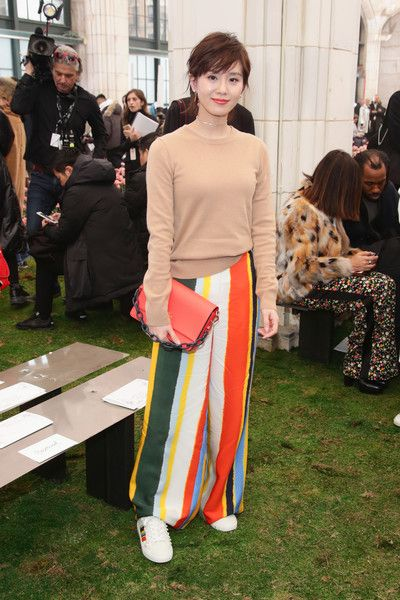 Actress Liu Shishi attends the Tory Burch Fall Winter 2018 Fashion Show during New York Fashion Week at Bridge Market on February 9, 2018 in New York City.