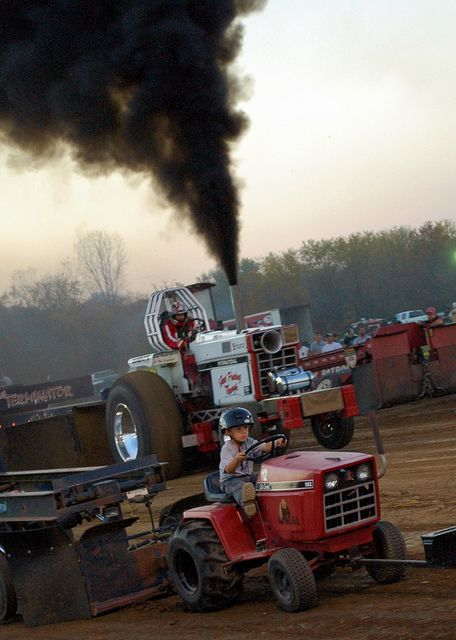 I don't know which one I like more the smokin' truck or the little boy on the mower?