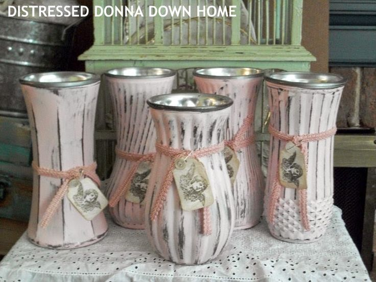 thrift store vases spray painted inside with silver metallic paint.  The outside was painted with pink chalk paint and distressed.  The tags add that little extra touch.  These are not to be used with water!