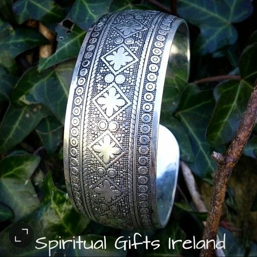 Filigree Amulet.  This beautifully carved amulet has detailed etched floral filigree and is adjustable to any size wrist. Perfect for stacking and super cute for festivals. Among China's 55 ethnic groups, the Tibetans are known for exquisite work with silver. Open ended bracelets have long been popular in Western Tibet and they can be very simple but highly ornate. The brushed silver finish adds a bohemian vibe to any outfit.  Bracelet size: Width:25mm Length: 195mm