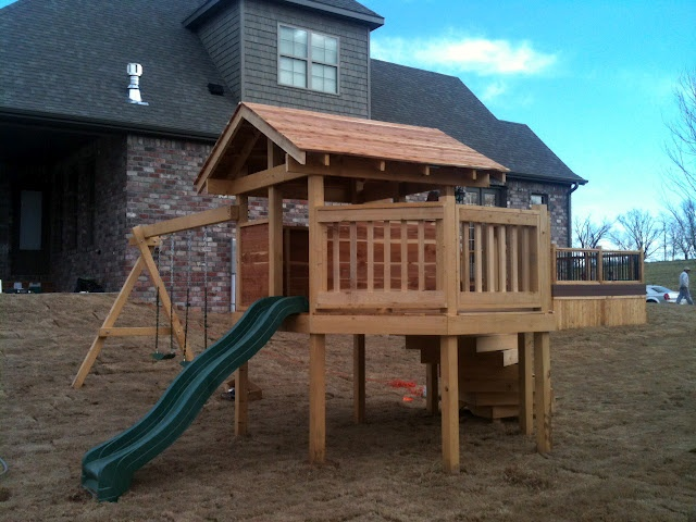 open air playhouse with spiral staircase designed for younger children playset swingset backyard