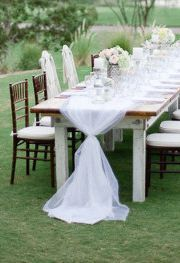 light pink tulle table runners for all guests tables the cake table and the gift table