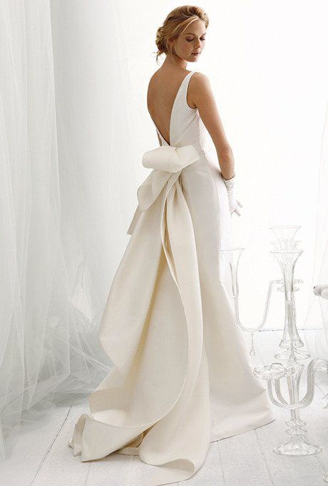 Stunning one-of-a-kind dress with an effortlessly draped, architectural bow…