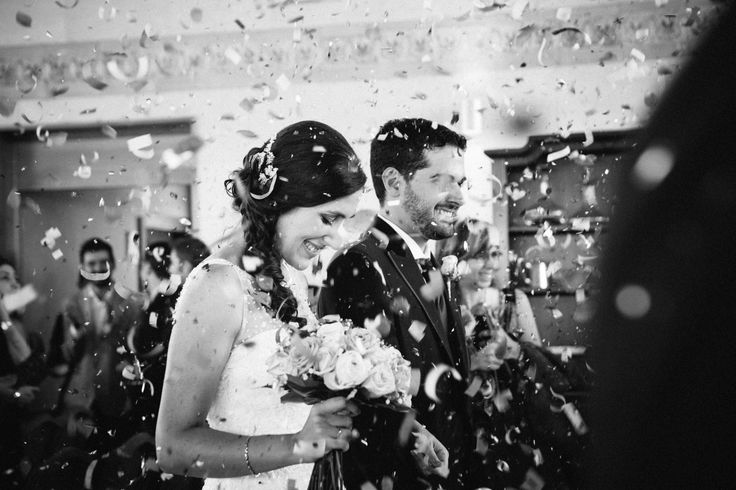 Leon Spain Destination wedding   Bride and groom confetti exit