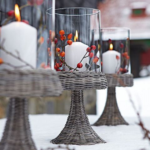 55 Winter Wedding Candles Ideas | HappyWedd.com I like the idea of the big vases with the berries. Maybe around the cake.